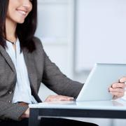 businesswoman using a tablet - stock photo
