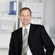 smiling handsome businessman - stock photo