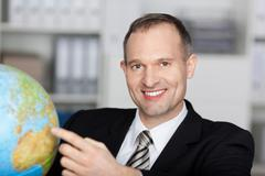 businessman with globe - stock photo