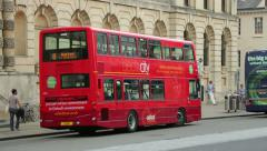 electric hybrid bus, high street, oxford, england on a sunny day - stock footage