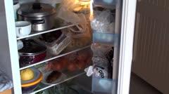 Closing Fridge full of food Stock Footage