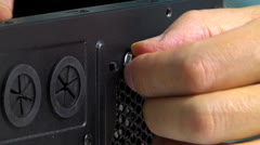 DIY Man use screw-driver screwing a screw into computer Stock Footage