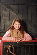 Pretty young girl in the stable Stock Photos