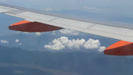 Stock Video Footage of Easy Jet plane wing in sky#