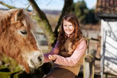 Portrait of a young happy girl and her horse Stock Photos