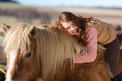 smiling young girl out riding - stock photo