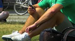 Student using Smartphone iPhone Campus Munich LMU university Germany Stock Footage