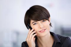 Woman telephoning with her smartphone Stock Photos