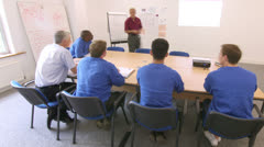 Time lapse of blue collar workers at a meeting or training seminar Stock Footage