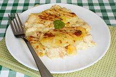 fish pie on cafe table - stock photo