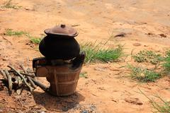 Clay pot with boiled water on fire stove, thailand. Stock Photos