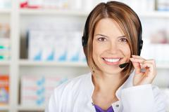 chemist woman with headset - stock photo