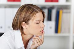 portrait of a thoughtful woman - stock photo