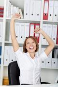 jubilant businesswoman - stock photo