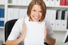 Smiling businesswoman show white paper Stock Photos