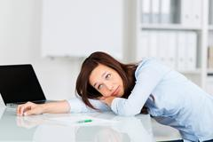 bored businesswoman - stock photo