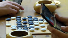 Chinese Japanese Korean strategy Go game board for beginner Stock Footage