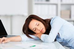 Tired businesswoman having a nap Stock Photos