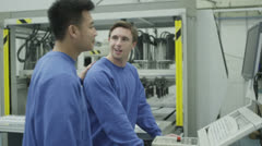 Cheerful factory or warehouse workers checking the machinery Stock Footage