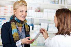 Customer buying medicine at the pharmacy Stock Photos