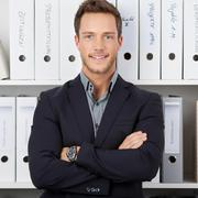 confident businessman in front of folders - stock photo