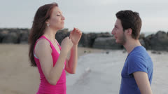 Marriage proposal - man gives a ring to a woman - kiss Stock Footage