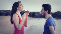 Marriage proposal - man declares his love to a woman - kiss Stock Footage