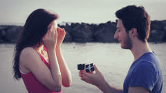 Man declares his love to a woman. man gives a ring to a woman. marriage proposal Stock Footage