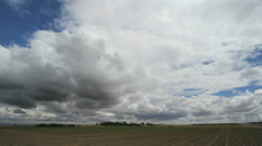 Clouds moving over a flat plain Stock Footage