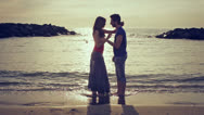 Couple in love dancing and kissing on the beach at sunset - sea and love Stock Footage