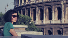 Tourist looks at the coliseum (Rome, Colosseum ,Colosseo) Stock Footage