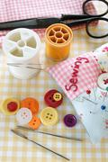 Sewing kit and textiles Stock Photos