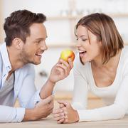 Couple with apple Stock Photos