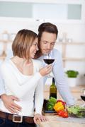 couple in kitchen - stock photo