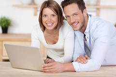 Lovely couple with laptop Stock Photos