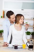 Young man feeds his girlfriend Stock Photos