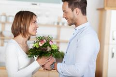 The gift of flowers Stock Photos
