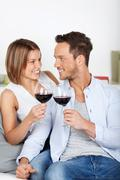 cheers with red wine - stock photo