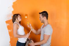 Couple having fun painting Stock Photos