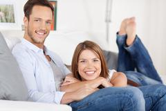 couple on couch - stock photo