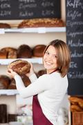 Friendly worker in a bakery Stock Photos