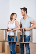 Teamwork - young couple moving house Stock Photos