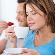 Pretty woman enjoying a cup of coffee Stock Photos