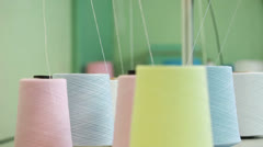 Colorful spools of thread background Stock Footage