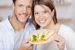 young couple with cheese platter - stock photo