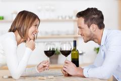 happy couple and red wine - stock photo