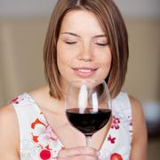 attractive woman enjoying red wine - stock photo