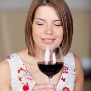 Attractive woman enjoying red wine Stock Photos