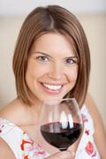 Smiling woman with a glass of red wine Stock Photos