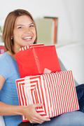Stock Photo of smiling woman with a pile of gifts